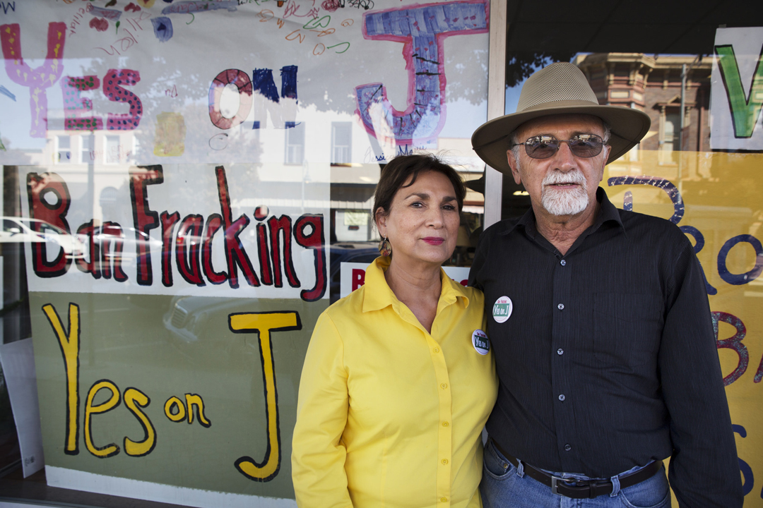 Margaret Morales Rebecchi stands with her husband Larry Rebecchi outside the Measure J office in Hollister, CA. The Measure passed in the November 2014 election and banned fracking in San Benito County.