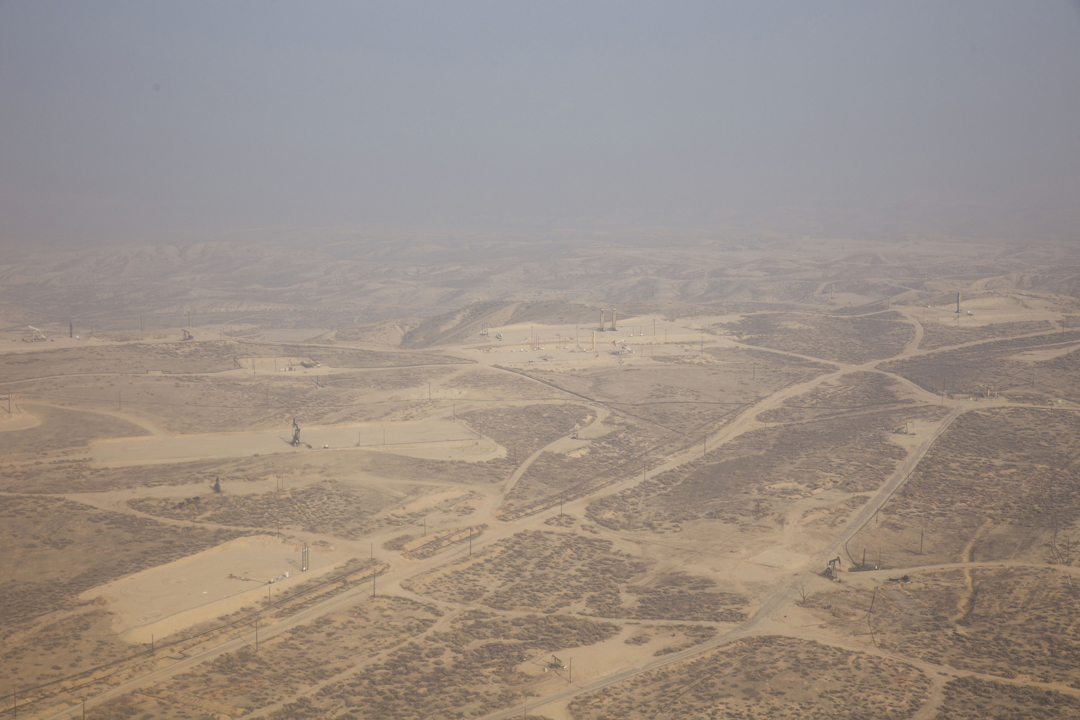 A hazy view of an oil field in Taft, California. Photo Credit: Faces of Fracking/Sarah Craig