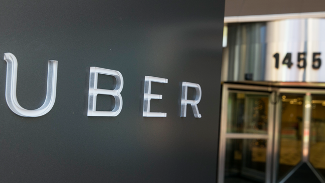 A logo sign outside of the headquarters of the ride sharing app, Uber, in downtown San Francisco, California, on Dec. 29, 2014. Photo Credit: Kristoffer Tripplaar/ Sipa USA *** Please Use Credit from Credit Field *** (Sipa/ AP Images)