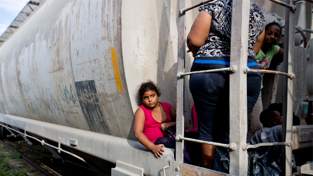 A surge of unaccompanied minors crossed the US-Mexico border last year, fleeing the poverty and gang violence crisis in their home country. (AP Photo/Eduardo Verdugo)