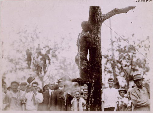 Large crowd looking at the burned body of Jesse Washington, 18 year-old African-American, lynched in Waco, Texas, May 15, 1916. (Library of Congress)
