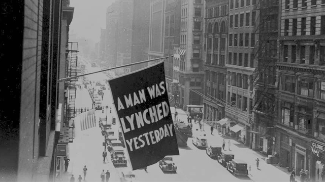 A flag announcing a lynching hangs from the window of the NAACP headquarters on 69 Fifth Ave., New York City. (Photo: Library of Congress)