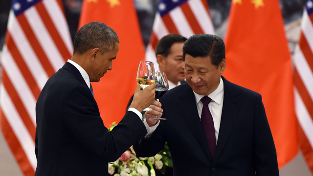 U.S. President Barack Obama, left, and Chinese President Xi Jinping toast at a lunch banquet in the Great Hall of the People in Beijing Wednesday, Nov. 12, 2014. Obama is on a state visit after attending the Asia-Pacific Economic Cooperation (APEC) summit. (AP Photo/Greg Baker, Pool)