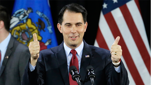 """FILE - In a Tuesday, Nov. 4, 2014 file photo, Wisconsin Republican Gov. Scott Walker gives a thumbs up as he speaks at his campaign party, in West Allis, Wisconsin. Less than two years ago, party leaders solemnly declared after an exhaustive study that the GOP """"must embrace and champion comprehensive immigration reform."""" It was critical for the party's survival, they said, to address an issue that was paramount to the nation's surging Hispanic population. But as President Obama issued a sweeping immigration order last week, some of the Republican Party's most prominent governors — likely presidential candidates among them — described immigration reform as little more than an afterthought. (AP Photo/Morry Gash, File)"""
