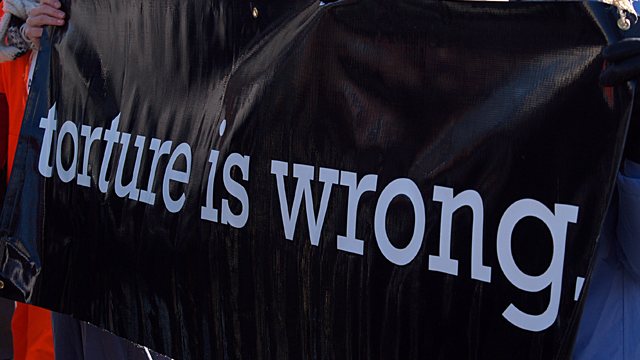 torture is wrong protest sign