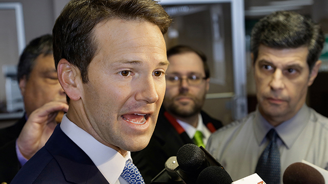 In this Feb. 6, 2015 photo, Rep. Aaron Schock speaks to reporters in Peoria, Illinois. Schock personally reimbursed $40,000 in congressional office renovations after a news report revealed the lavish-looking decorations. (Photo by Seth Perlman/AP)