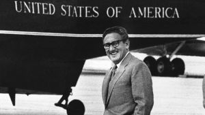 Henry Kissinger, President Nixon's foreign affairs adviser, smiles as he walks to a helicopter at Andrews Air Force Base near Washington, Saturday, August 19, 1972. Nixon summoned Kissinger to Camp David to discuss his mission to Vietnam. (AP Photo)