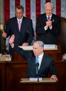 Israeli Prime Minister Benjamin Netanyahu prepares to address a joint meeting of Congress in the House chamber as Speaker John Boehner, R-Ohio, left, and Sen. Orrin Hatch, R-Utah, president pro tempore of the Senate, on look, March 3, 2015.