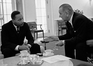 LBJ and MLK discussing and writing