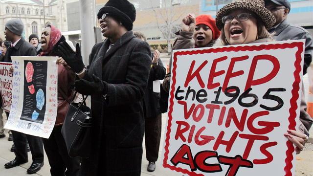 Jane B. Sheats, right, demonstrates in front of the Cuyahoga County Board of Elections Tuesday, April 4, 2006 in Cleveland. Clergy, especially ministers at black churches, along with some public officials marched Tuesday to raise public interest in reauthorization of some provisions of the Voting Rights Act which could expire in 2007. The federal legislation dates back to 1965.(AP Photo/Tony Dejak)