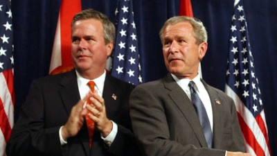** FILE ** President George W. Bush, right, and his brother, Fla. Gov. Jeb Bush, decide which way to leave the stage after speaking at a Republican fund raiser in Coral Gables, Fla., in this April 23, 2004 file picture. Could there be a third President Bush? The current chief said Wednesday May 10, 2006 that younger brother Jeb would make a great one, too, and has asked him about making a run. The first President Bush likes the idea as well. (AP Photo/ Susan Walsh)