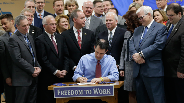 Wisconsin Gov. Scott Walker signs a right-to-work bill into law on March 9. The new law, which takes effect immediately, makes Wisconsin the 25<sup><p class=