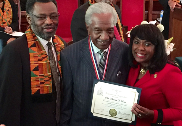 Rep. Terri Sewell (right) presents a gold certificate to Frederick Douglas Reese (center), with the Rev. Leodis Strong, at Brown Chapel A.M.E. Church, February 2015. (Photo: Ari Berman)