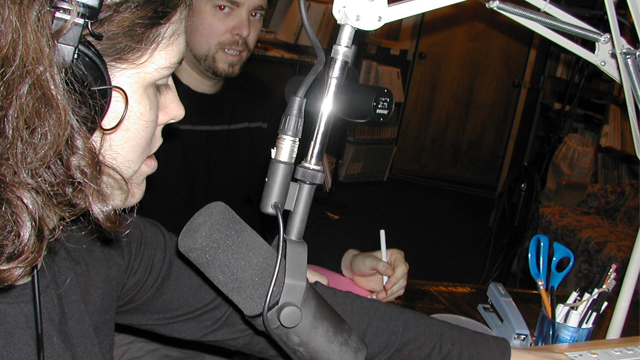 Amelia Kirby, left, and Nick Szuberla of WMMT-FM in Whitesburg, Kentucky, prepare for a prisoner call-in show, Thursday, Dec. 16, 2004. The show will let families of inmates share holiday greetings over the airwaves. (Photo by Roger Alford/AP)