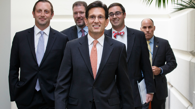 House Majority Leader Eric Cantor, R-Va., arrives to meet with fellow Republicans on the day after his defeat in the Virginia primary at the hands of tea party challenger David Brat, at the Capitol in Washington, Wednesday, June 11, 2014. Cantor announce that he will resign his leadership post at the end of July. (AP Photo/J. Scott Applewhite)