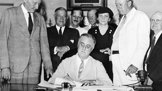 FDR signs social security act in 1935