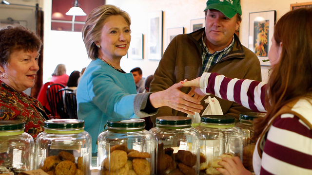 Democratic presidential candidate Hillary Rodham Clinton shakes hands at Kristin's Bakery during her first New Hampshire campaign stop, Monday, April 20, 2015, in Keene, N.H. (AP Photo/Jim Cole)