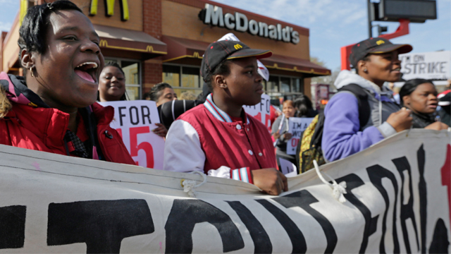 McDonald's workers and supporters rally outside a McDonald's, Wednesday, April 15, 2015, in Chicago. Fast-food workers calling for $15 an hour are picking up some more allies Wednesday. Airport workers, home care workers, Walmart workers and adjunct professors are among those set to join in the fight for $15 protests across the country, in what organizers are calling the biggest ever mobilization of workers in the U.S. (AP Photo/M. Spencer Green)