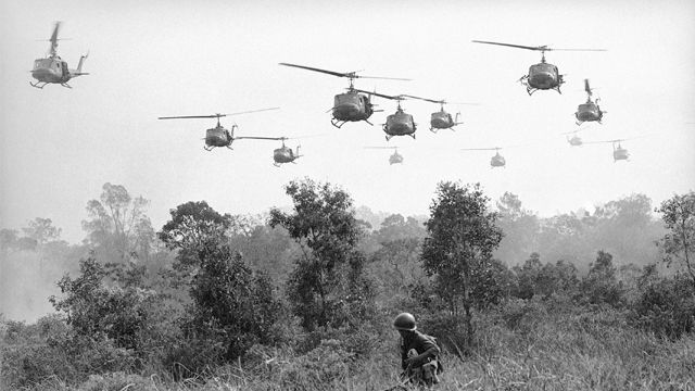 Hovering U.S. Army helicopters pour machine gun fire into tree line to cover the advance of Vietnamese ground troops in an attack on a Viet Cong camp 18 miles north of Tay Ninh on March 29, 1965, which is northwest of Saigon near the Cambodian border. Combined assault routed Viet Cong guerrilla force. (AP Photo/Horst Faas)