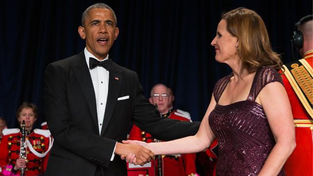 President Barack Obama, left, is greeted by White House Correspondents Association president Christi Parsons during the White House Correspondents' Association dinner at the Washington Hilton on Saturday, April 25, 2015, in Washington. (Photo by Evan Vucci/AP)