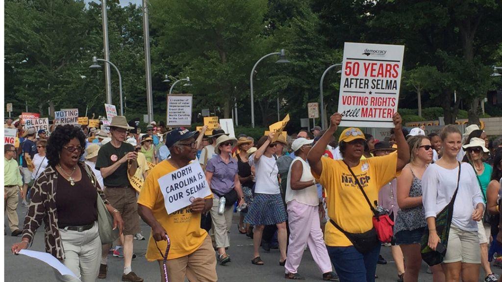 Voting rights activists march through downtown Winston-Salem. (Ari Berman)