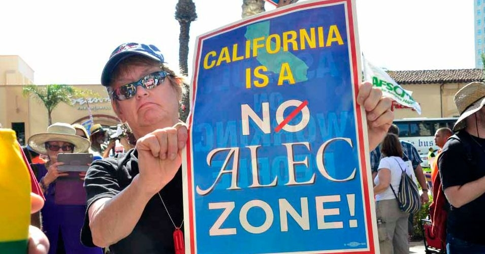 """Protesters carried signs and chanted """"ALEC, go home"""" during an afternoon demonstration outside the Manchester Grand Hyatt Hotel on Wednesday. (Photo: Chris Stone/Times of San Diego)"""