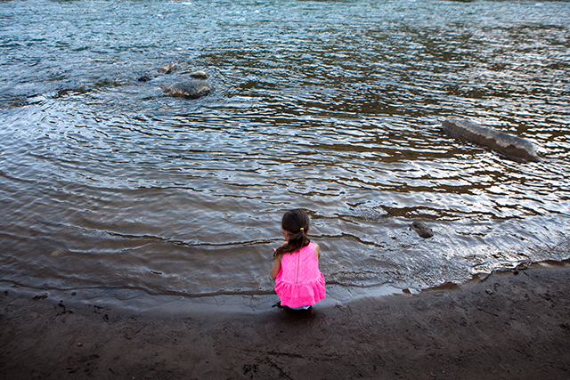 Emersen Sud crouches along a bank of the Animas River, in Durango, Colorado, August 14, 2015. A recent accident that leaked a toxic yellow plume of sludge from the Gold King mine into the Animas River heightened a debate over the future of this region's old mines. (Photo: Mark Holm/The New York Times)
