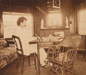 Photograph of Samuel Clemens at desk in Elmira, NY. (1874?)