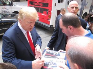 Donald Trump signing autographs outside NBC when he arrives for The Tonight Show on Friday, Sept. 11, 2015 (Credit: Andrew Dallos, Flickr / CC 2.0)