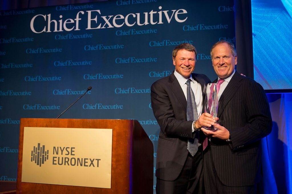 Honeywell Chairman and CEO Dave Cote (right) accepts Chief Executive Magazine's 2013 CEO of the Year award from the 2012 recipient, Yum! Brands CEO David Novak (left).
