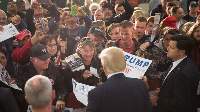 Republican presidential candidate Donald Trump greets guests at a campaign event at Mississippi Valley Fairgrounds on December 5, 2015 in Davenport, Iowa. Trump continues to lead the most polls in the race for the Republican nomination for president. (Photo by Scott Olson/Getty Images)