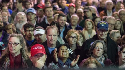 People watch a monitor inside the venue while Republican presidential candidate Donald Trump speaks to the crowd at a Pearl Harbor Day Rally At U.S.S. Yorktown December 7, 2015 in Mt. Pleasant, South Carolina. The South Carolina Republican primary is scheduled for February 20, 2016. (Photo by Sean Rayford/Getty Images)
