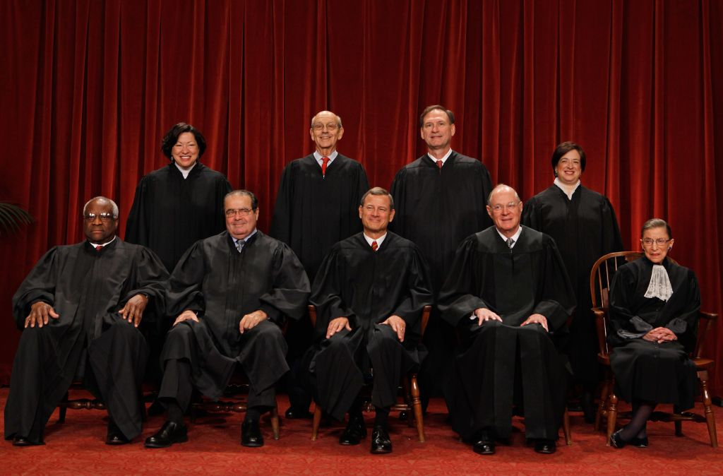 US Supreme Court members (first row L-R) Associate Justice Clarence Thomas, Associate Justice Antonin Scalia, Chief Justice John Roberts, Associate Justice Anthony Kennedy, Associate Justice Ruth Bader Ginsburg, (back row L-R) Associate Justice Sonia Sotomayor, Associate Justice Stephen Breyer, Associate Justice Samuel Alito and Associate Justice Elena Kagan pose for photographs in the East Conference Room at the Supreme Court building October 8, 2010 in Washington, DC.  (Photo by Chip Somodevilla/Getty Images)