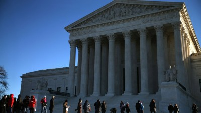 People wait in line to enter the US Supreme Court building January 11, 2016 in Washington, DC. (Photo by Mark Wilson/Getty Images)