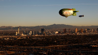 """The Greenpeace A.E. Bates thermal airship flies over Las Vegas urging Hillary Clinton to reject fossil fuel money. The airship carries two messages, one which reads """"Don't Gamble With Our Democracy"""" and a second message to Secretary Clinton urging her to """"Say No To Fossil Fuel Money"""". (Photo: Steve Marcus/Greenpeace)"""