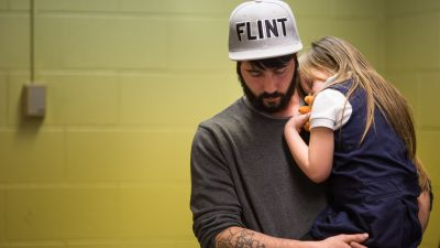 FLINT, MI - JANUARY 26: Matt Hopper holds and comforts Nyla Hopper, age 5 of Flint, after she has her blood drawn to be tested for lead on January 26, 2016 at Eisenhower Elementary School in Flint, Michigan. Free lead screenings are performed for Flint children 6-years-old and younger, one of several events sponsored by Molina Healthcare following the city's water contamination and federal state of emergency. (Photo by Brett Carlsen/Getty Images)