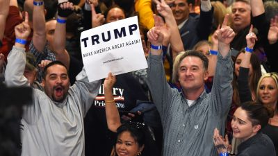 """LAS VEGAS, NV - FEBRUARY 23: Supporters cheer while waiting for Republican presidential candidate Donald Trump to speak at a caucus night watch party at the Treasure Island Hotel & Casino on February 23, 2016 in Las Vegas, Nevada. The New York businessman won his third state victory in a row in the """"first in the West"""" caucuses. (Photo by Ethan Miller/Getty Images)"""