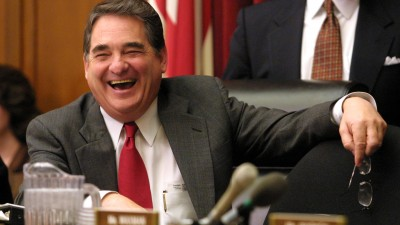 """385602 24: House Energy and Commerce Committee Chairman Rep. W.J. """"Billy"""" Tauzin (R-LA) laughs prior to a hearing on election night 2000 coverage by the networks before the House committee on energy and commerce February 14, 2001 on Capitol Hill in Washington, D. C. (Photo by Alex Wong/Newsmakers)"""