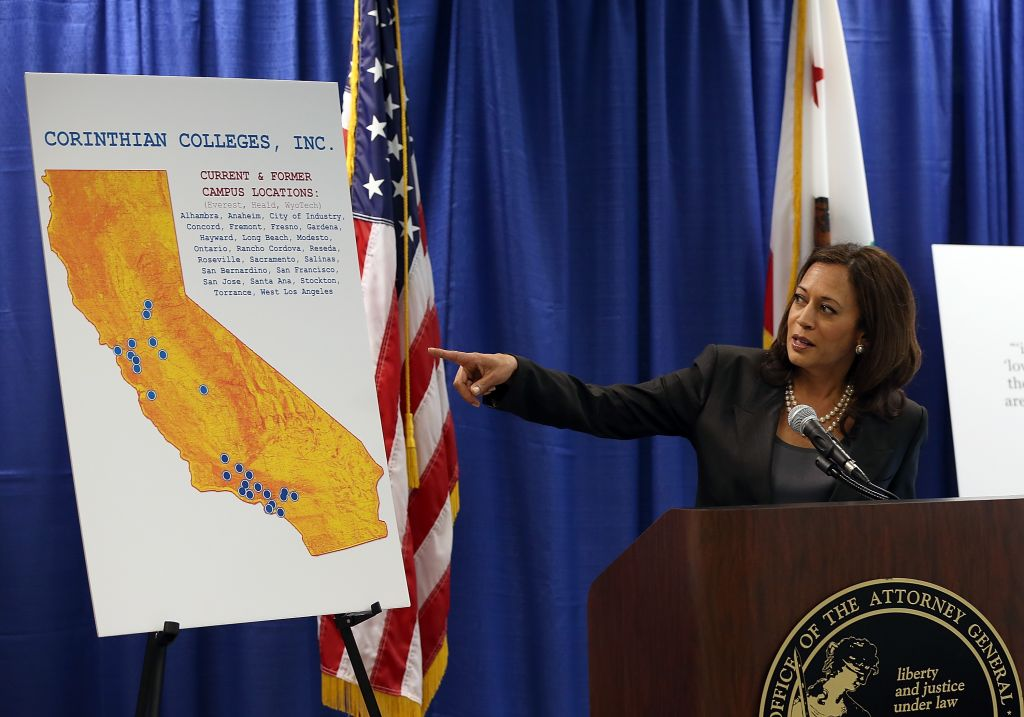 SAN FRANCISCO, CA - OCTOBER 10:  California Attorney General Kamala Harris points to a map as she speaks during a news conference on October 10, 2013 in San Francisco, California. Harris announced the filing of a lawsuit against the for-profit Corinthian Colleges and its subsidiaries for alleged false advertising, securities fraud, intentional misrepresentations to students and the unlawful use of military insignias in advertisements. Santa Ana, California-based Corinthian Colleges operates 111 total campuses in North America with 24 Heald, Everest and WyoTech colleges in California that have an estimated 27,000 students.  (Photo by Justin Sullivan/Getty Images)