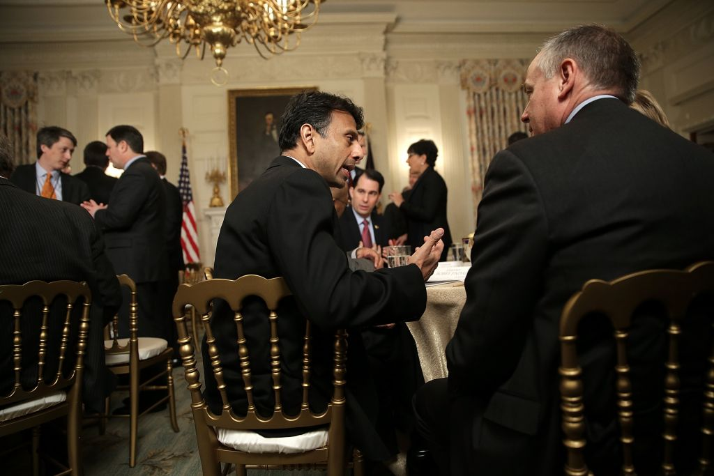 Louisiana Gov. Bobby Jindal (C) (R-LA) talks with fellow state governors before President Barack Obama addressed members of the National Governors Association at the White House February 23, 2015 in Washington, DC. Also pictured is Wisconsin Gov. Scott Walker (2nd R) (R-WI). (Photo by Win McNamee/Getty Images)