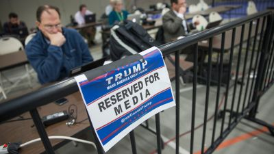 Members of the news media file stories and pictures from the press pen following a rally with Republican presidential candidate Donald Trump at Macomb Community College on March 4, 2016 in Warren, Michigan. (Photo by Scott Olson/Getty Images)