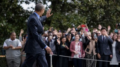 US President Barack Obama waves to people while walking to Marine One on the South Lawn of the White House March 11, 2016 in Washington, DC. (Photo credit: Brendan Smialowski/AFP/Getty Images)