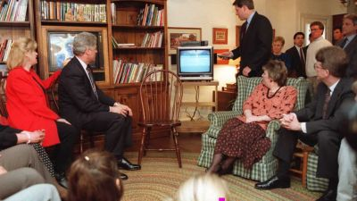Vice President Al Gore speaks as President Bill Clinton looks on during an informal discussion with parents and children in Alexandria, Virginia on Feb. 9, 1996. Clinton had signed the Telecommunications Act the previous day. (Photo by Paul J. Richards/AFP/Getty Images)