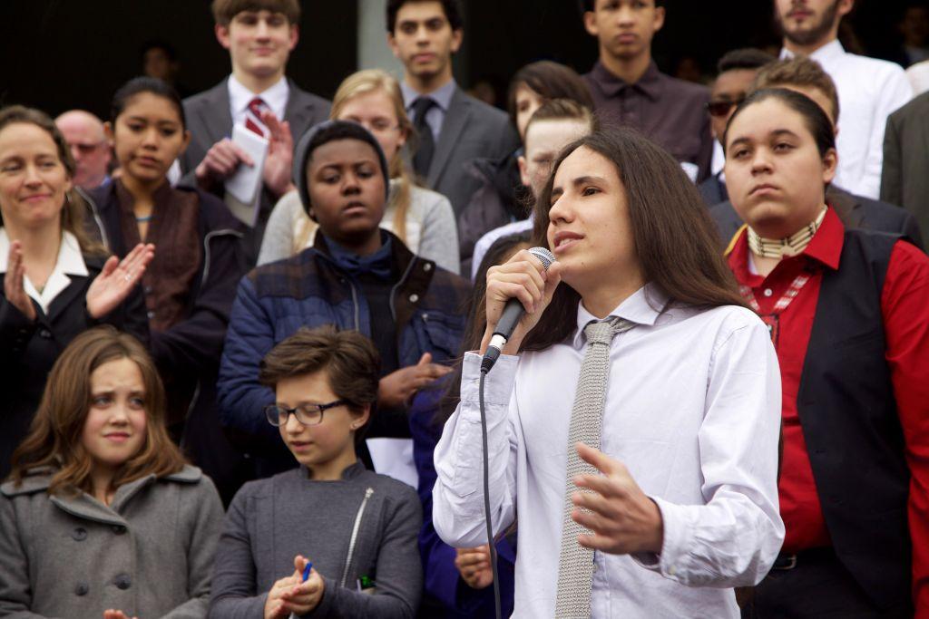 Xiuhtezcatl Tonatiuh Martinez (15) stands in front of his fellow plaintiffs and addresses the press. (Clayton Aldern/Grist)
