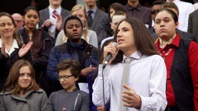 Xiuhtezcatl Tonatiuh Martinez (15) stands in front of his fellow plaintiffs and addresses the press in March 2016. (Clayton Aldern/Grist & BillMoyers.com)
