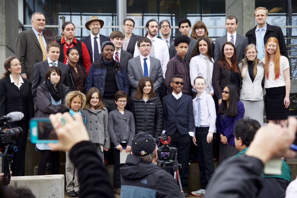 The 21 youth plaintiffs, along with climatologist James Hansen (top, third from left) pose with Our Children's Trust attorneys Phil Gregory (top left) and Julia Olson (bottom left). (Clayton Aldern/Grist)