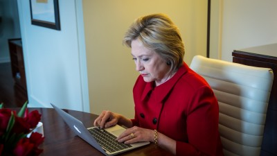 Hillary Clinton types on her keyboard during a Reddit chat in Detroit, MI on March 6, 2016. (Photo courtesy of Hillary for America on Flickr)