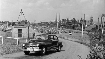 The caption of this 1950 photo says it depicts American steelworker Charlie Grapentine drives his Dodge car home from work. He earns $320 per month for a 40-hour week at the United States Steel Corporation works in Youngstown, Ohio. His salary supports his wife Josephine and their two children Charles and Nancy. US Steel closed its Youngstown works in 1980. (Photo by Doreen Spooner/Keystone Features/Getty Images)