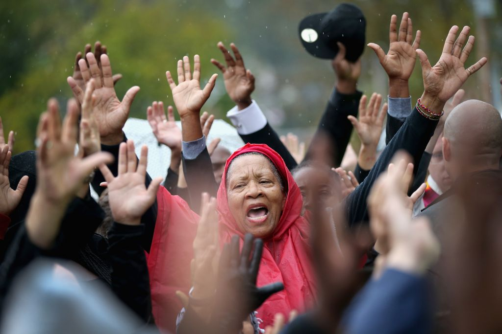 FERGUSON, MO - OCTOBER 13: Demonstrators confront police outside the Ferguson police station on October 13, 2014 in Ferguson, Missouri. Ferguson has been struggling to heal since riots erupted following the August 9, killing of 18-year-old Michael Brown by a police officer in suburban Ferguson. Another teenager, Vonderrit Myers Jr., was killed by a St. Louis police officer on October 8. Several demonstrators and members of the clergy were arrested at the protest after a show of civil disobedience. (Photo by Scott Olson/Getty Images)