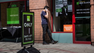 NEW YORK, NY - APRIL 15: A man talks on the phone before going into an H&R Block on April 15, 2015 in New York City. Today is the deadline for filing federal income taxes. (Photo by Andrew Burton/Getty Images)